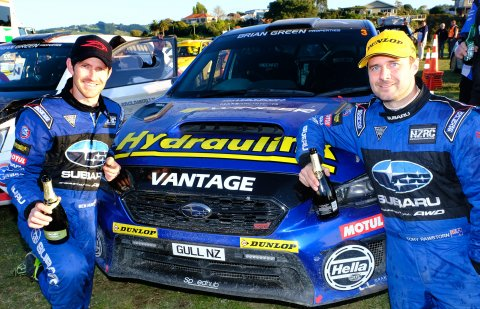 Subaru brand ambassador Ben Hunt (left) and his co-driver Tony Rawstorn celebrate next to their Subaru WRX STI after Hunt was second in the 2018 NZRC Driver's Championship and Rawstorn won the Co-Driver's Championship. PHOTO: GEOFF RIDDER.