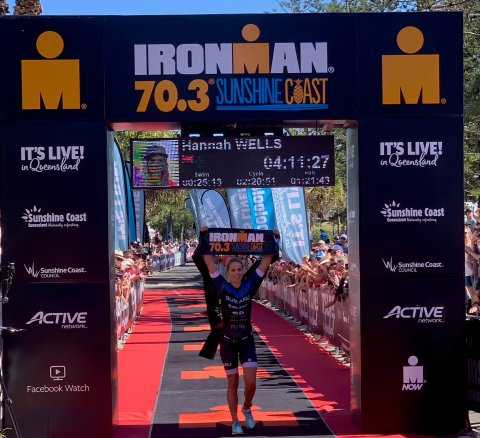 Subaru brand ambassador Hannah Wells crosses the Ironman 70.3 Sunshine Coast finish line in first place  today. PHOTO: NICK BERRY.