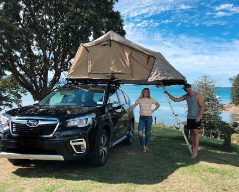 Art and Matilda Green camping with their Subaru Forester.