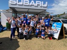 Team Subaru at Round the Bays 2020 celebrating at the finish line Subaru stand.