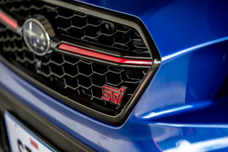 The limited edition 2021 Subaru Saigo WRX STI has a front grille with a red pin stripe.