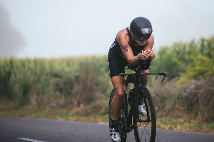 Sticking to her race plan, Hannah Wells opened up a lead on the 180km bike leg. PHOTO CREDIT: JEMMA WELLS.