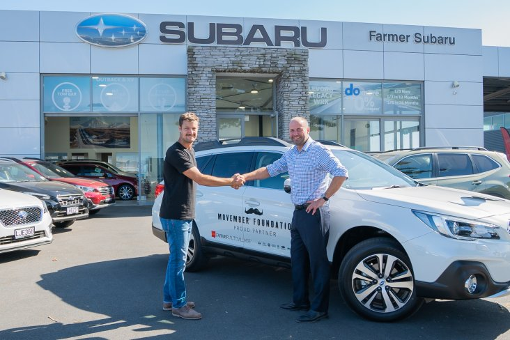 Movember Foundation New Zealand Manager Robert Dunne (left) picks up a Subaru Outback from Farmer Autovillage Group Managing Director Mike Farmer.