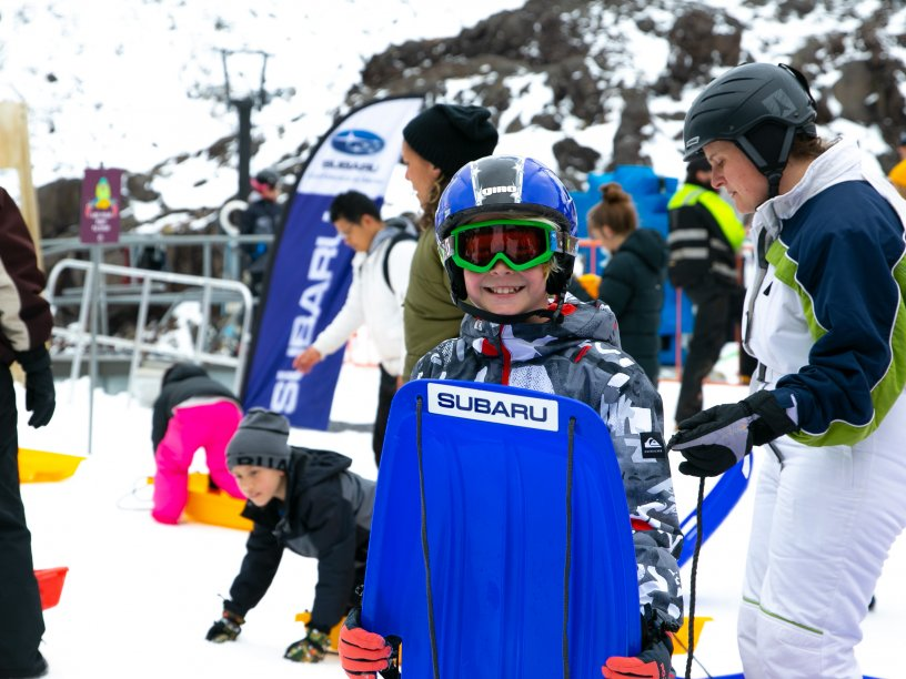 This winter, families can enjoy the newly branded Subaru Sledding Zone and slide their way down the racetrack from the Subaru blue start line.