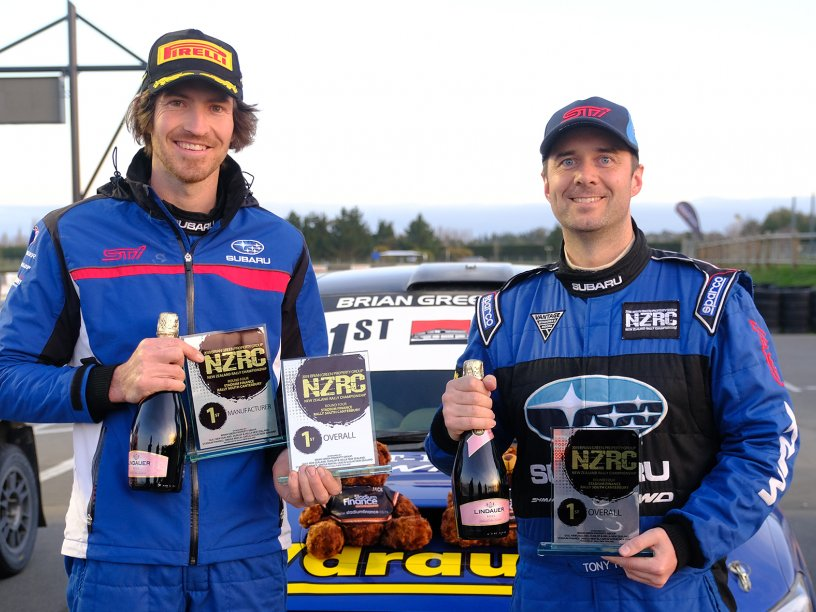 Subaru brand ambassador Ben Hunt (left) and co-driver Tony Rawstorn with their NZRC winners' trophies after the Stadium Finance South Canterbury Rally today. PHOTO: GEOFF RIDDER.